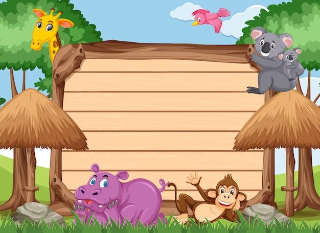 Plantilla de madera con muchos animales salvajes en el parque