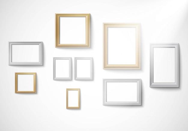 Plantilla de marco de imagen de oro y plata en blanco aislada en la pared con luz