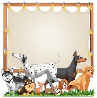 Plantilla de marco de madera de lona con lindo grupo de perros aislado