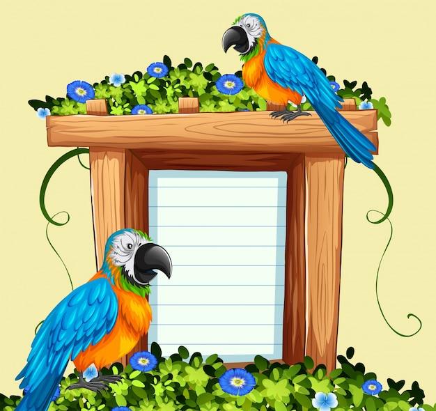 Plantilla de papel con dos pájaros macaw