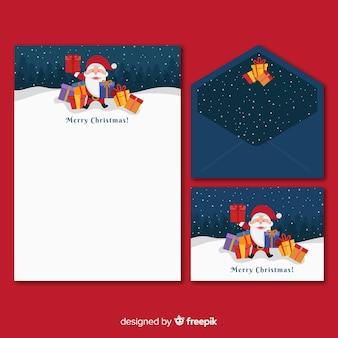 Plantilla de papelería plana de navidad con santa claus