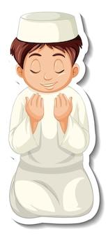 Una plantilla de pegatina con un niño musulmán rezando.