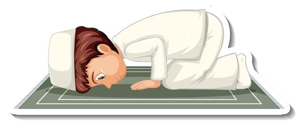 Una plantilla de pegatina con un niño musulmán sentado en una alfombra y rezando.