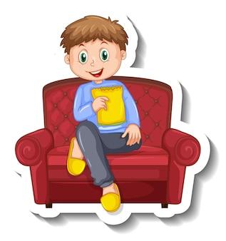 Una plantilla de pegatina con un niño sentado en el sofá.