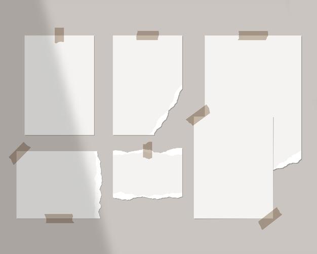 Plantilla de tablero de estado de ánimo. hojas vacías de papel blanco en la pared con superposición de sombras.