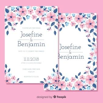Plantilla de tarjeta de boda floral en diseño plano