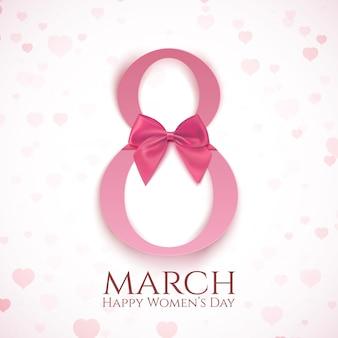 Plantilla de tarjeta de felicitación de marzo con lazo rosa y corazones borrosos. día internacional de la mujer