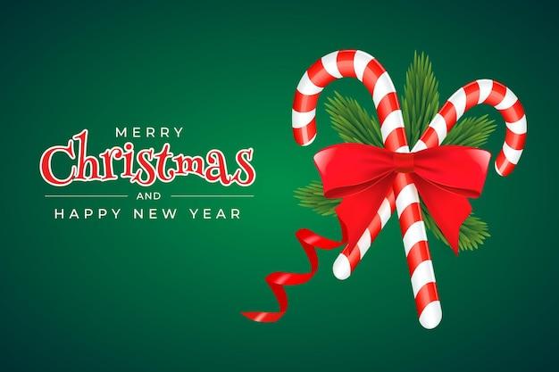 Plantilla de tarjeta de felicitación de navidad y año nuevo con ramas de abeto dulces, lazo rojo y cinta