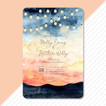 Plantilla de tarjeta de invitación de boda con luz de cadena y acuarela de paisaje