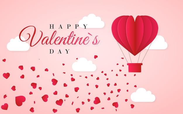 Plantilla de tarjeta de invitación de feliz día de san valentín con globo de aire caliente de papel rojo origami en forma de corazón, nubes blancas y confeti. fondo rosa.