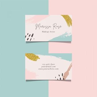 Plantilla de tarjeta de visita con elemento de pincel y pincel dorado