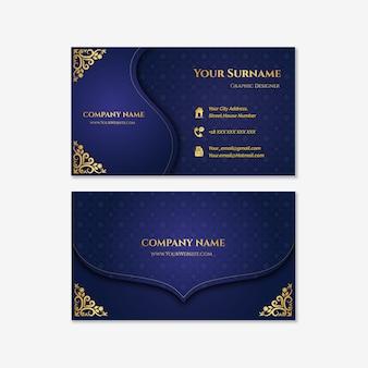 Plantilla de tarjeta de visita de lujo dorado y azul