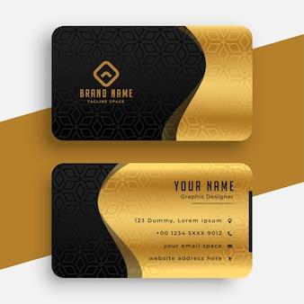 Plantilla de tarjeta de visita ondulada premium negra dorada