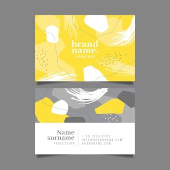 Plantilla de tarjeta de visita orgánica amarilla y gris