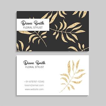 Plantilla de tarjeta de visita de oro de lujo con hojas tropicales.