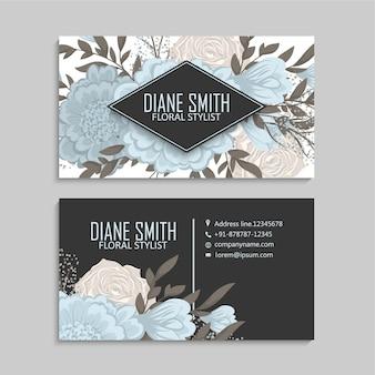 Plantilla de tarjetas de visita de flor azul en fondo oscuro