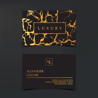 Plantilla de vector de tarjetas de visita negras de lujo con detalles de hoja de oro.