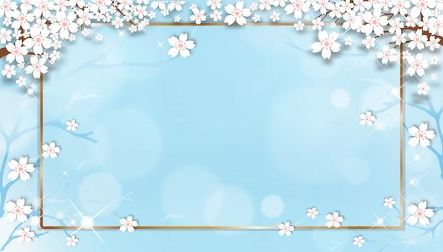 Plantilla de venta de primavera con ramas de cerezo en flor con marco dorado sobre fondo azul pastel.