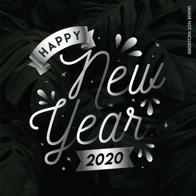 Plata feliz año nuevo 2020 en hojas tropicales