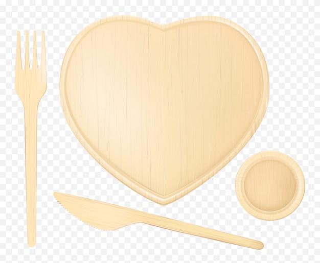 Plato corazón de madera con tenedor, cuchillo y vaso