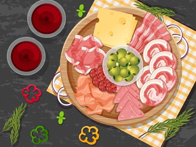 Plato de embutidos y carne ahumada en el fondo de la mesa