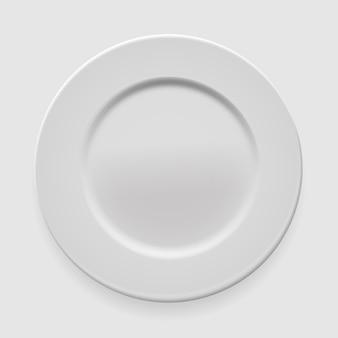 Plato redondo blanco vacío sobre fondo claro para su diseño