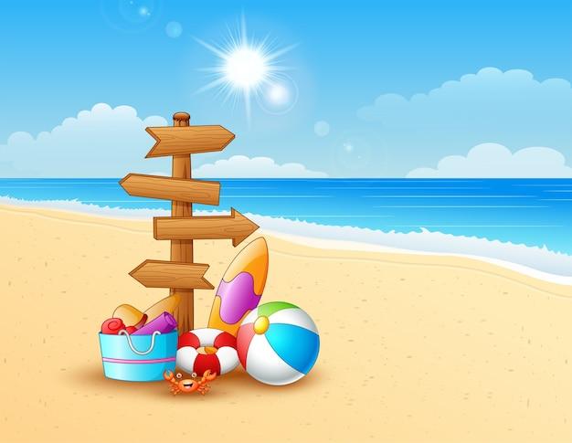 Playa de verano con flecha de madera
