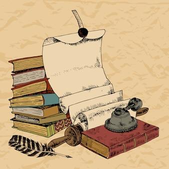 Pluma de papel y libros