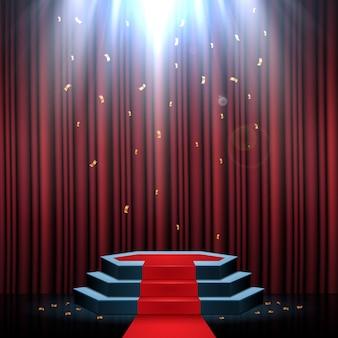 Podio con alfombra roja y cortina iluminada por focos.