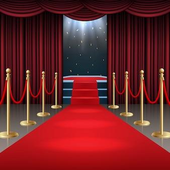 Podio con alfombra roja y cortina en resplandor de focos.