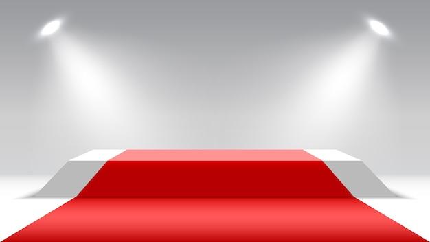 Podio con alfombra roja y focos. pedestal en blanco. escenario para entrega de premios.