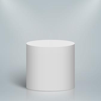 Podio o plataforma redonda iluminada vacía. cilindro en blanco blanco