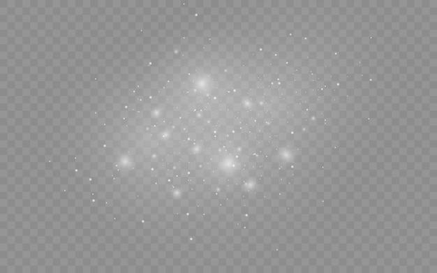 El polvo blanco chispea y brilla con una luz especial, efecto de luz, partículas de polvo mágico brillantes aisladas sobre fondo transparente, luces brillantes, brillo.