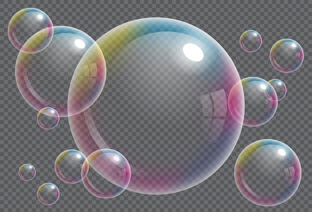Pompas de jabón transparentes con la reflexión del arco iris