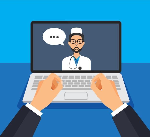 Portátil abierto con médico masculino en una pantalla