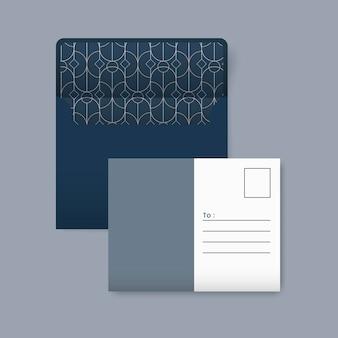 Postal azul y blanca con un patrón geométrico dorado.