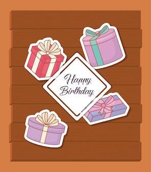 Postal de feliz cumpleaños con cajas de regalos