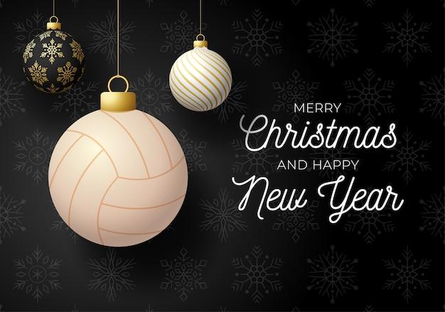 Postal deportiva de lujo feliz navidad y próspero año nuevo. pelota de voleibol como una bola de navidad sobre fondo negro.