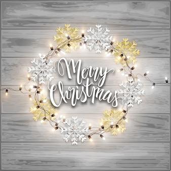 Postal de feliz navidad, copos de nieve brillantes y luces led guirnalda brillante