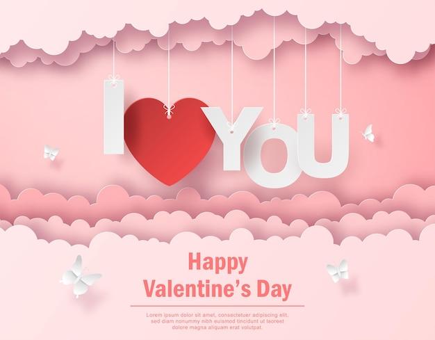 Postal de san valentín con texto colgante te amo en el cielo feliz día de san valentín