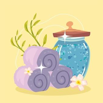 Póster con elementos de toallas de spa y sales minerales.