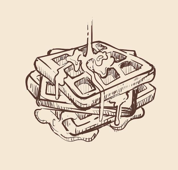 Postre gofres hinchados vertidos con dibujo de jarabe