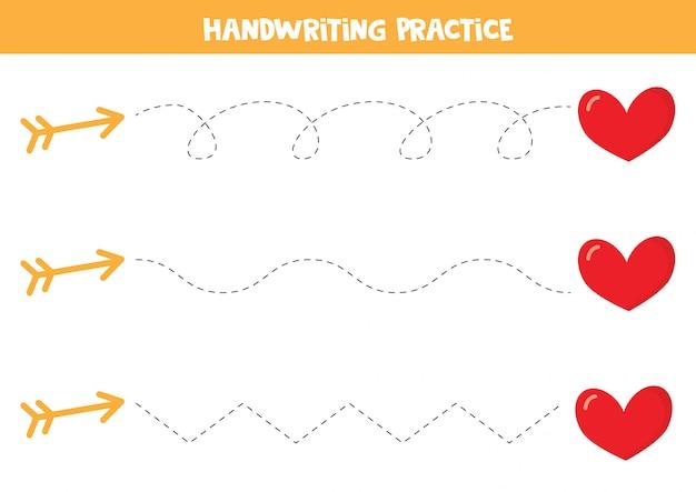 Práctica de escritura a mano con flechas y corazones.