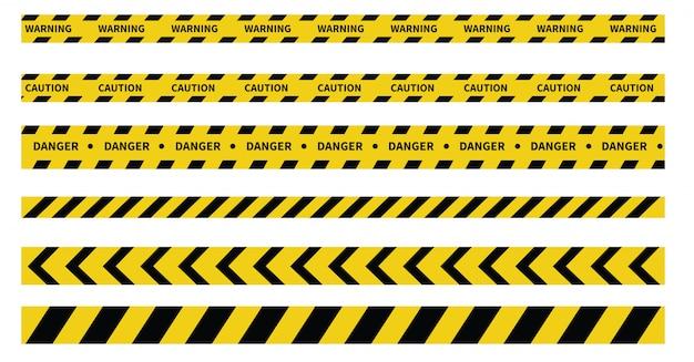 Precaución y cintas de peligro. cinta de advertencia. línea negra y amarilla a rayas.