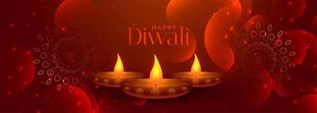 Preciosa pancarta feliz de diwali con tres lámparas diya