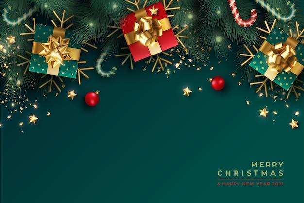 Precioso fondo navideño con decoración realista en verde y rojo.