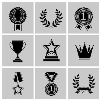 Premio conjunto de iconos negro de corona estrella laurel corona aislada vector ilustración