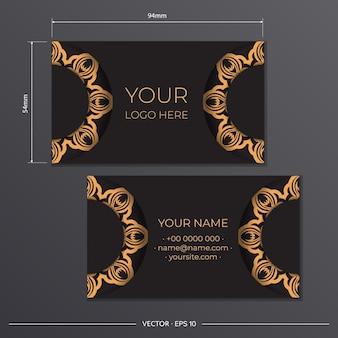 Preparación de tarjetas de visita con adornos griegos. diseño de tarjeta de visita negra con patrones vintage.