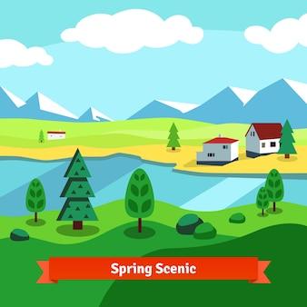 Primavera rural granja ribereña escénica con montañas