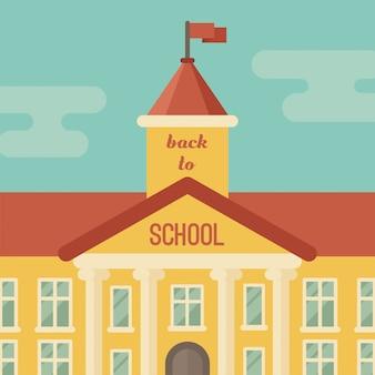 Primer plano del edificio escolar con texto volver a la escuela